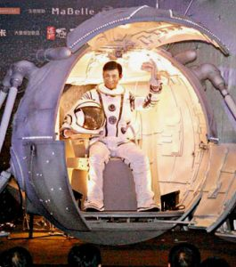 Andy Lau promotes concert in spaceman outfit